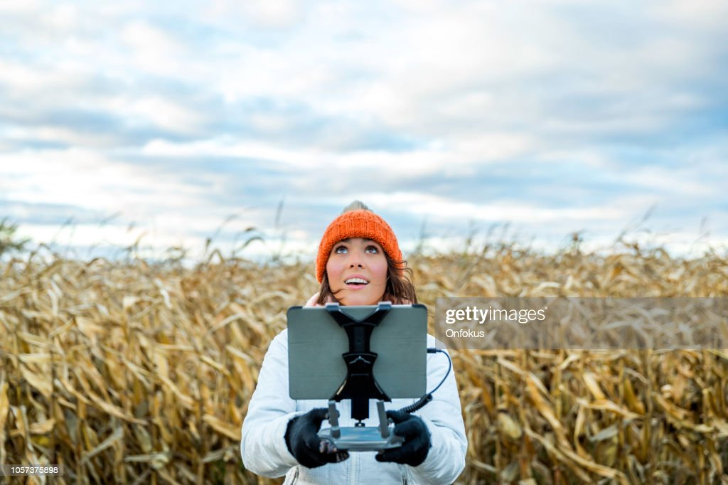 Woman Pilot Using Drone Remote Controller with a Tablet Mount : Stock Photo