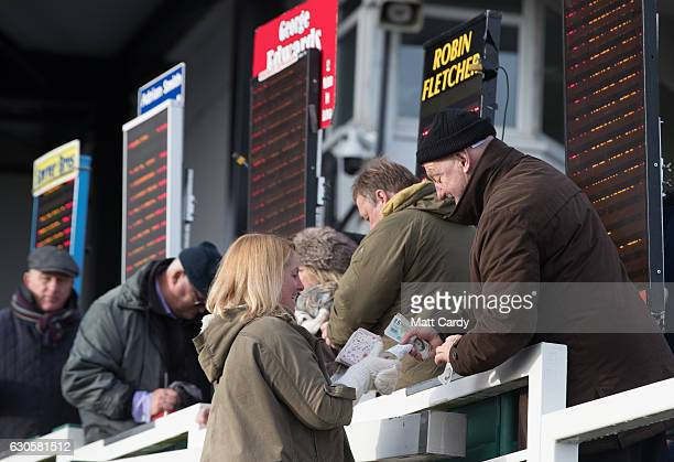 A woman places a bet ahead of the first race during the 2016 Coral Welsh Grand National at Chepstow Racecourse on December 27 2016 in Chepstow Wales...