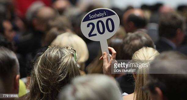 A woman places a bid at Sotheby's 14 November 2007 in New York Sotheby's was holding their sale of contemporary art AFP PHOTO/DON EMMERT