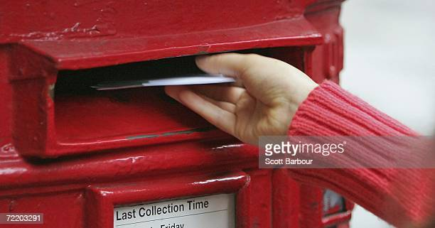 A woman places a letter inside a post box on October 18 2006 in London England A petition of four million names will be handed into Downing Street...