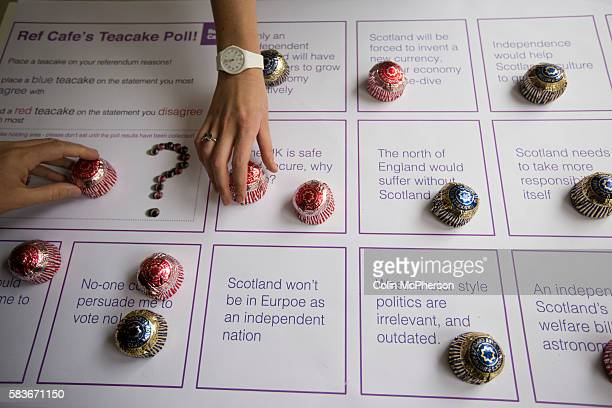 Woman places a tea cake on a board statements about independence the Referendum Cafe in the centre of Glasgow on the day that Scotland voted in the...