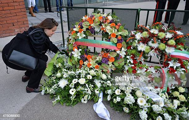 Woman places a wreath during a ceremony marking the 30th anniversary of the tragedy at the stadium, renamed King Baudouin Stadium, in Brussels, on...
