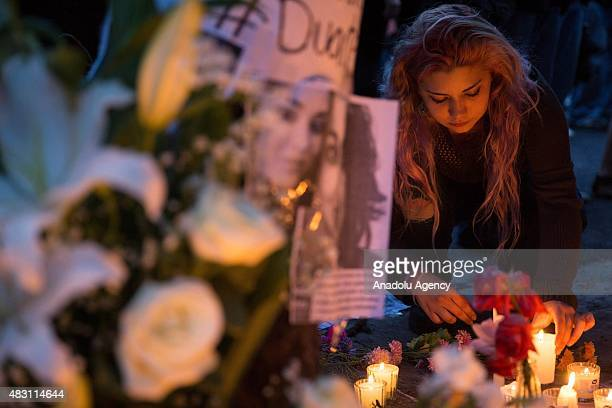 A woman places candles during a protest outside the apartment where the murder of Ruben Espinosa took place to demand justice and the clarification...