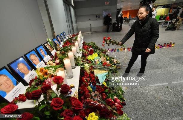 A woman places flowers at a memorial for the victims of the Ukraine International Airlines Boeing 737800 crash in the Iranian capital Tehran at the...