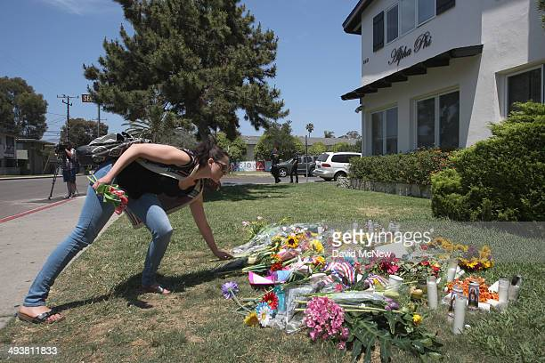 A woman places flowers on the lawn of the Alpha Phi sorority house May 25 2014 in Isla Vista California According to reports 22 year old Elliot...