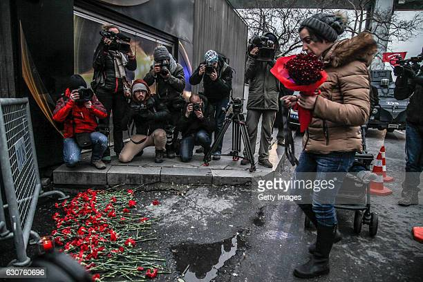 A woman places flowers outsidethe Reina nightclub by the Bosphorus following a gun attack on New Year's Eve on January 1 2017 in Istanbul Turkey...