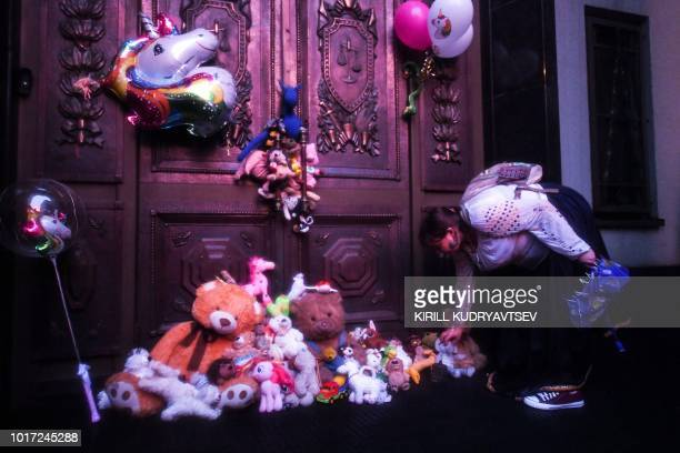 A woman places stuffed toys in front of the Russian Supreme Court during a rally to demand the release of two teenagers accused of 'extremism' in a...