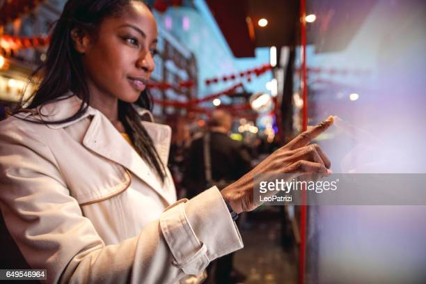 Woman placing an order using a touch screen