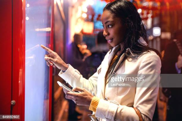 woman placing an order using a touch screen - touch screen stock pictures, royalty-free photos & images