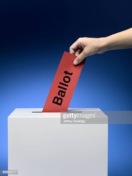 Woman placing ballot in ballot box