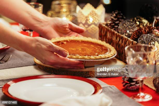 woman placing pie on festive table - (position) stock pictures, royalty-free photos & images