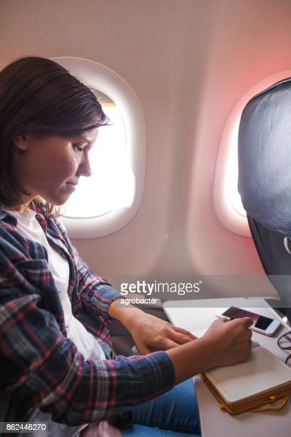 Woman planning a trip in plane