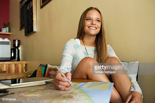 Woman planning trip with world map