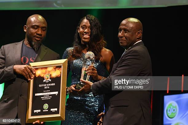 Woman Player of the Year Asisat Oshoala receives her award during the African Footballer of the Year Awards in Abuja on January 5 2017 Algerian and...