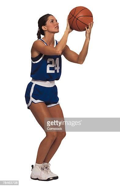 Woman player shooting basketball