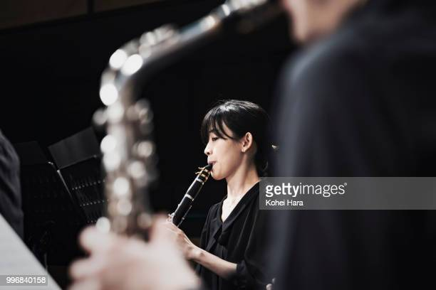 Woman playing a clarinet at concert hall