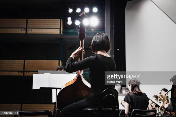 Woman playing a contrabass at concert hall