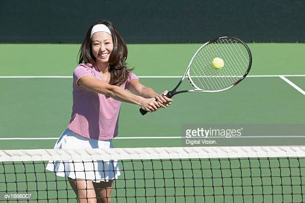 Woman Playing a Game of Tennis
