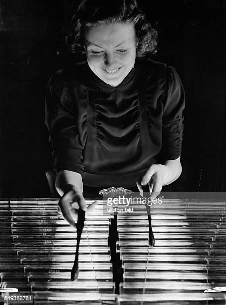 A woman playing a glockenspiel made of glas ca 1937 Photographer Heinz von Perckhammer Vintage property of ullstein bild