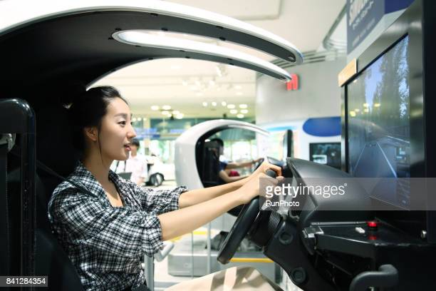woman playing a racing game