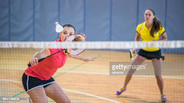 woman playing badminton - racquet sport stock photos and pictures