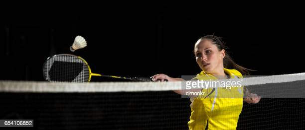 Woman playing badminton