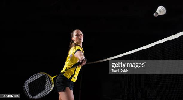 woman playing badminton - badminton stock photos and pictures