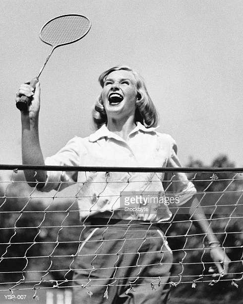 woman playing badminton - badminton sport stock photos and pictures