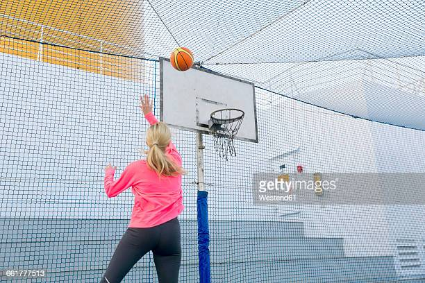 Woman playing basketball on a deck of a cruise ship