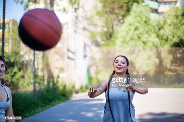 woman playing basketball on outdoor court - flick stock pictures, royalty-free photos & images
