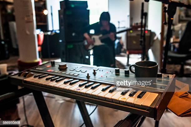 woman playing bass in the background - keyboard player stock photos and pictures