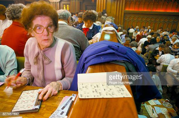 A woman playing Bingo at a hall in South London
