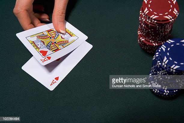 Woman playing blackjack in casino