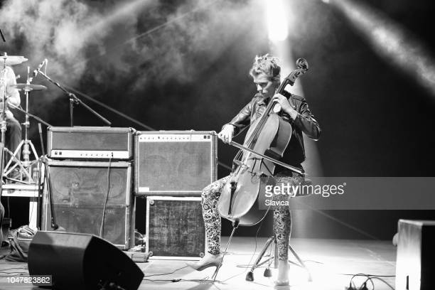 woman playing cello on the stage - musician stock pictures, royalty-free photos & images