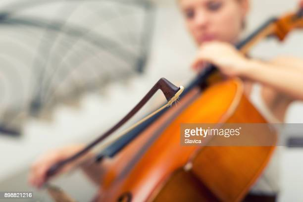 woman playing cello on the stage - string instrument stock photos and pictures