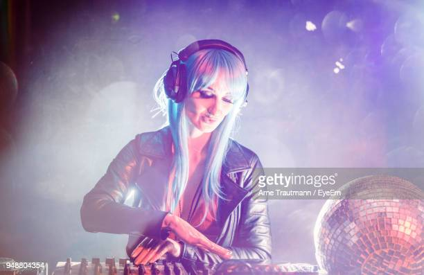 Woman Playing Dj At Music Concert