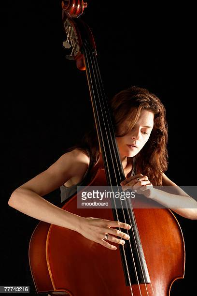 woman playing double bass - double bass stock photos and pictures