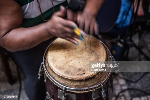 woman playing drum - brazilian atabaque - brazilian carnival stock pictures, royalty-free photos & images