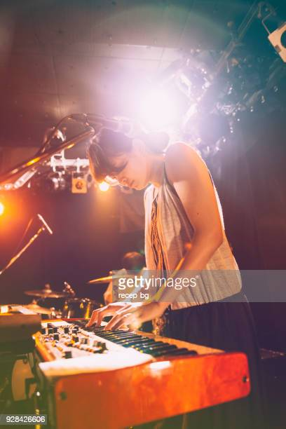 Woman Playing Electronic Keyboard At Live Event
