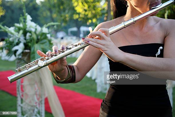 woman playing flute - classical stock pictures, royalty-free photos & images