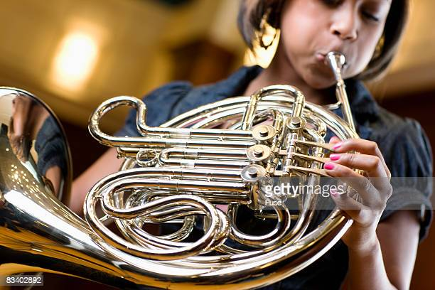 Woman Playing French Horn
