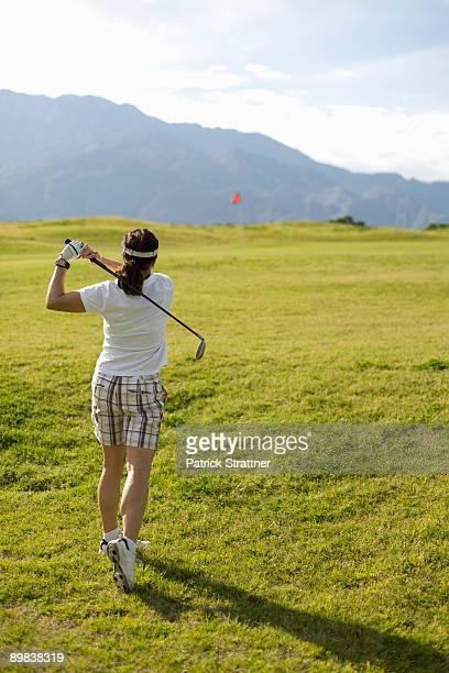 A woman playing golf, Palm Springs, California, USA
