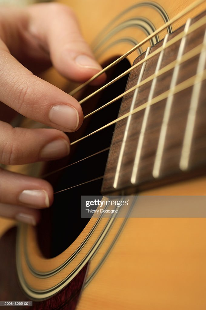 Woman playing guitar : Stock Photo
