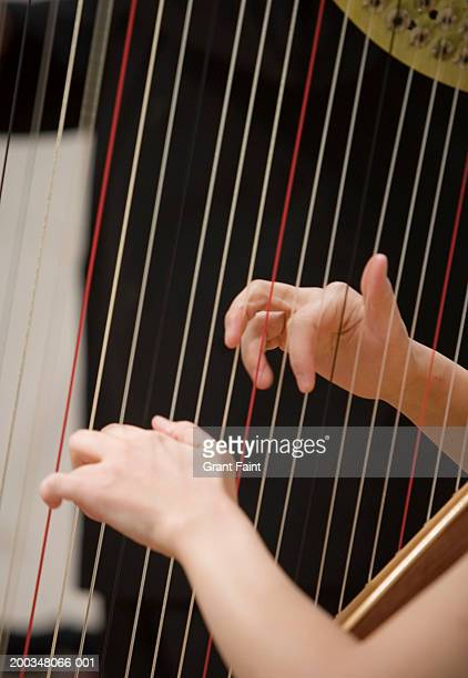 woman playing harp, close-up - stringed instrument stock pictures, royalty-free photos & images
