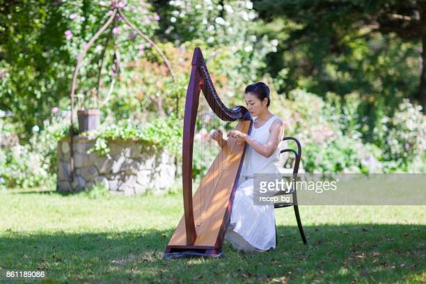 Woman Playing Harp Outdoors