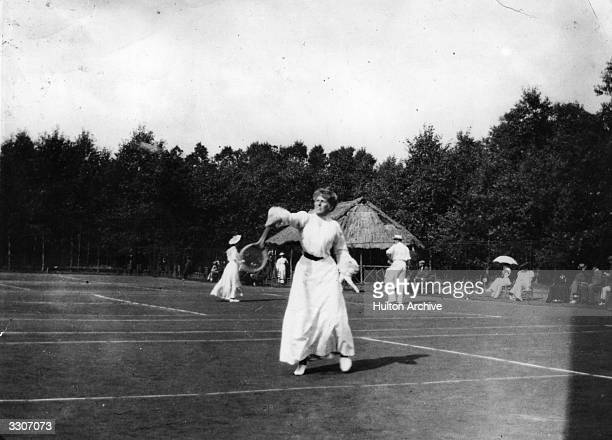 A woman playing in a tennis tournament at Le Touquet France