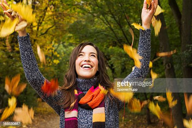 woman playing in autumn leaves - throwing stock pictures, royalty-free photos & images