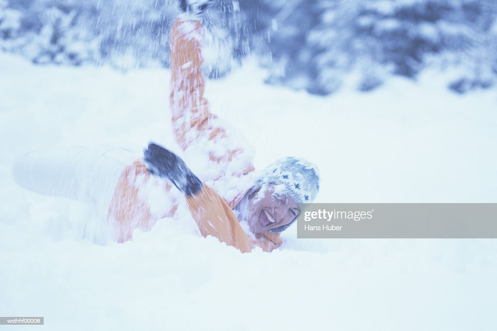 Woman playing in snow : Stock Photo