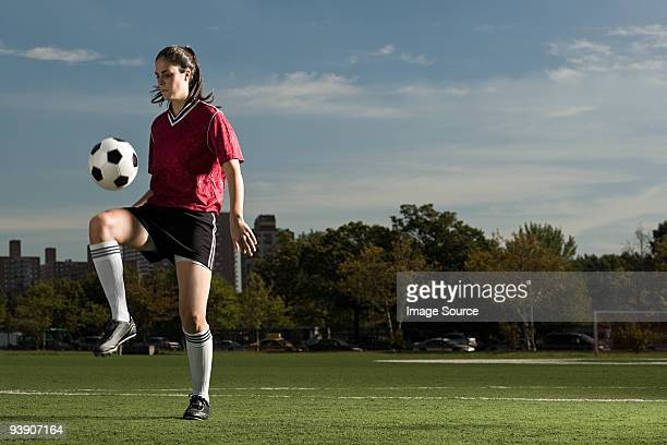 Woman playing keepy uppy