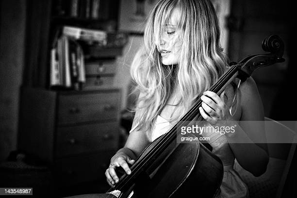 woman playing music on cello - cello stock pictures, royalty-free photos & images